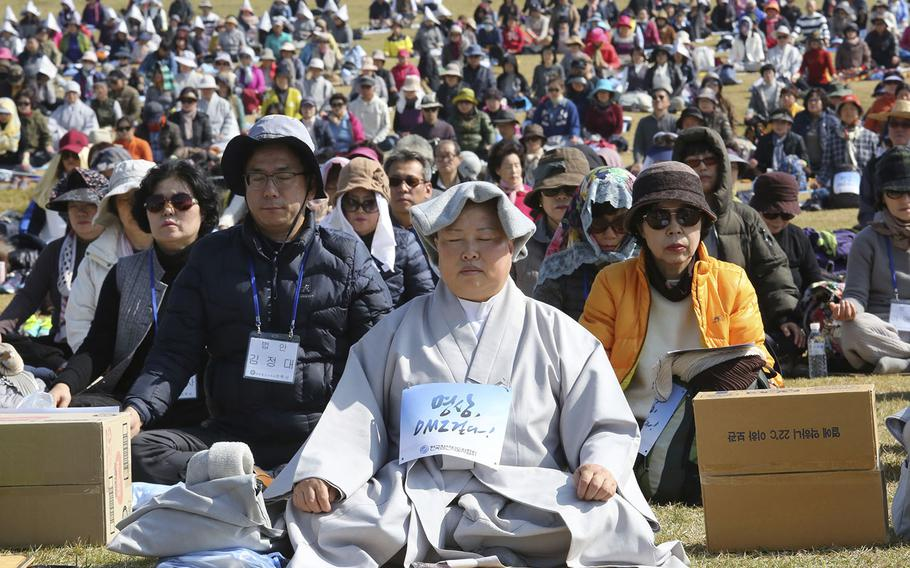 Buddhist believers attend the Demilitarized Zone World Peace Meditation Event at Imjingak Pavilion in Paju near the demilitarized zone of Panmunjom, South Korea, Saturday, Oct. 13, 2018. Thousands of Buddhists believers prayed for peace and denuclearization on the Korean Peninsula.