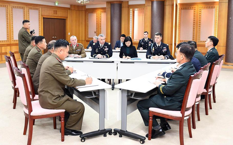 Army Col. Burke Hamilton, secretary of the United Nations Command's military armistice committee, joins North and South Korean military officials during the first trilateral meeting on disarming the border area. The meeting was held on the South Korean side of Panmunjom, Tuesday, Oct. 16, 2018.