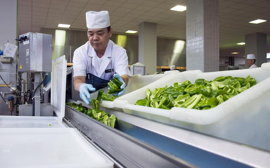 A Japanese worker prepares vegetables for eight Marine Corps dining halls on Okinawa, Friday, Oct. 12, 2018.