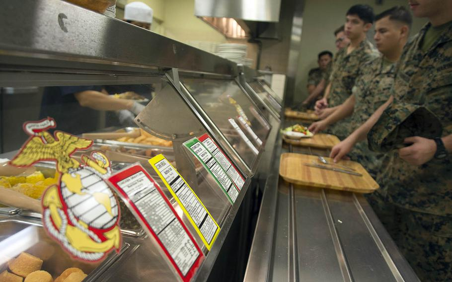 Marines stand in line for lunch at the 12th Marines Mess Hall at Camp Hansen, Okinawa, Friday, Oct. 12, 2018.