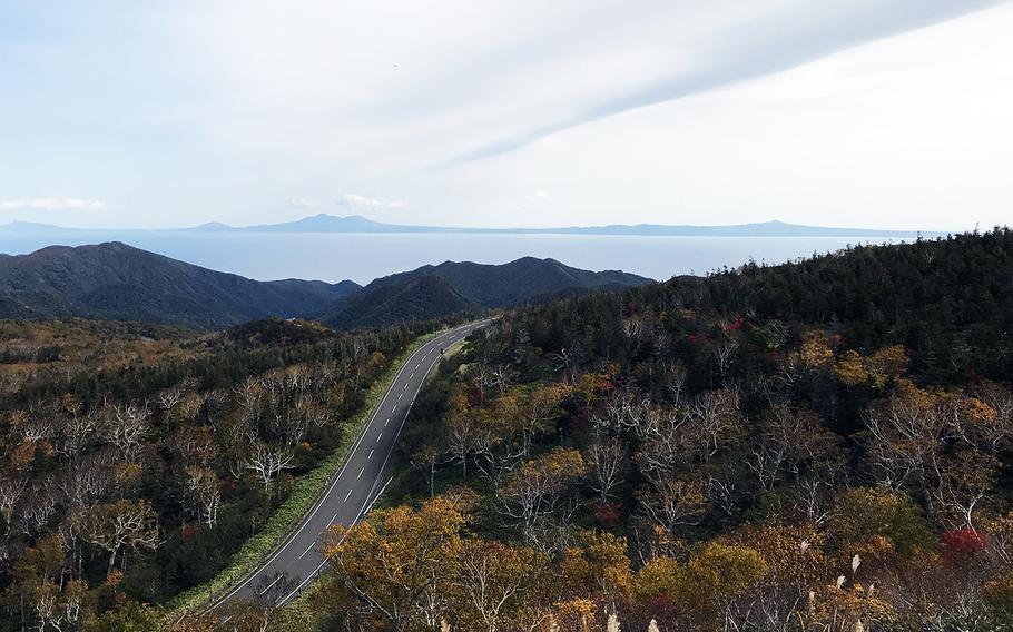 Russia-controlled Kunashiri Island is seen in the distance from the Shiretoko Peninsula on Hokkaido, Japan.