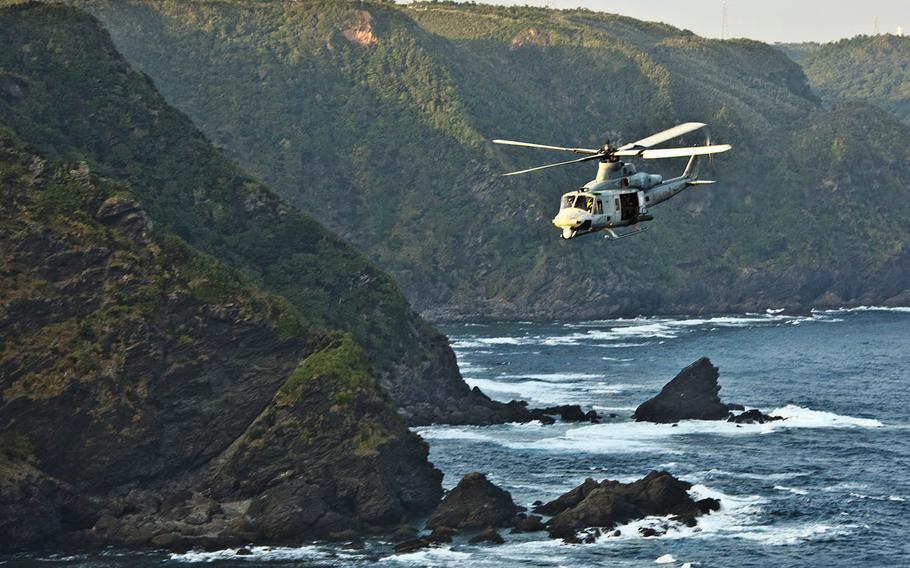 A Marine Corps UH-1Y Venom flies toward Camp Schwab, Okinawa, Nov. 9, 2017.