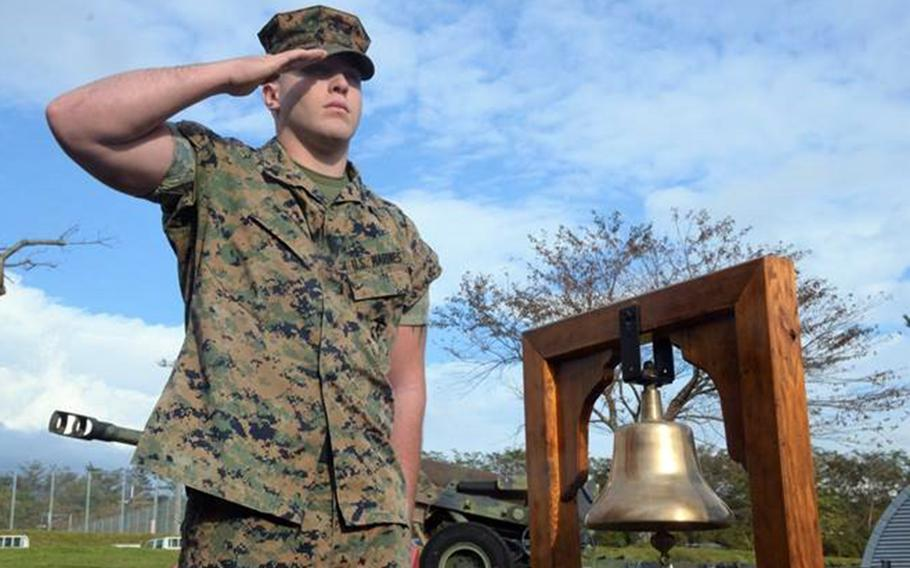 A Marine salutes during a remembrance ceremony Friday, Oct. 19, 2018, for 13 Marines killed in a fire at Camp Fuji, Japan, in October 1979.