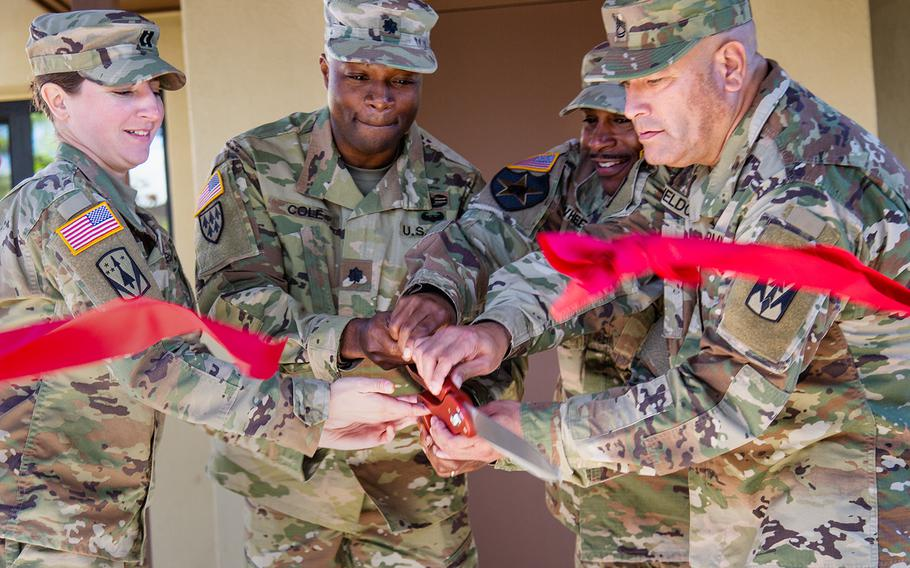 A ribbon is cut to celebrate the opening of the new home of Delta Battery, 2nd Air Defense Artillery Regiment at Camp Carroll, South Korea, Friday, Oct. 19, 2018.