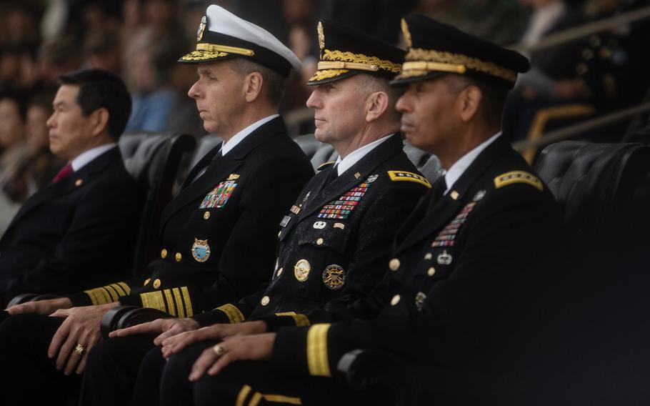 Incoming U.S. Forces Korea commander Robert Abrams, center, sits between Adm. Phil Davidson, left, Indo-Pacific Command leader, and outgoing USFK commander Gen. Vincent Brooks, at Camp Humphreys, South Korea, Thursday, Nov. 8, 2018.