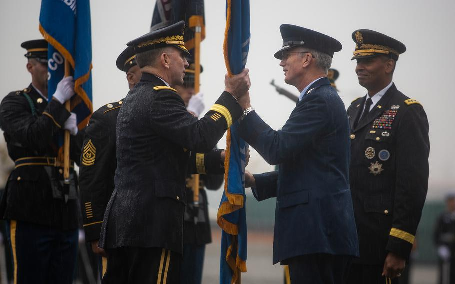 Gen. Paul Selva, vice chairman of the Joint Chiefs of Staff, right, passes the United Nations Command colors to incoming U.S. Forces Korea commander Gen. Robert Abrams at Camp Humphreys, South Korea, Thursday, Nov. 8, 2018.