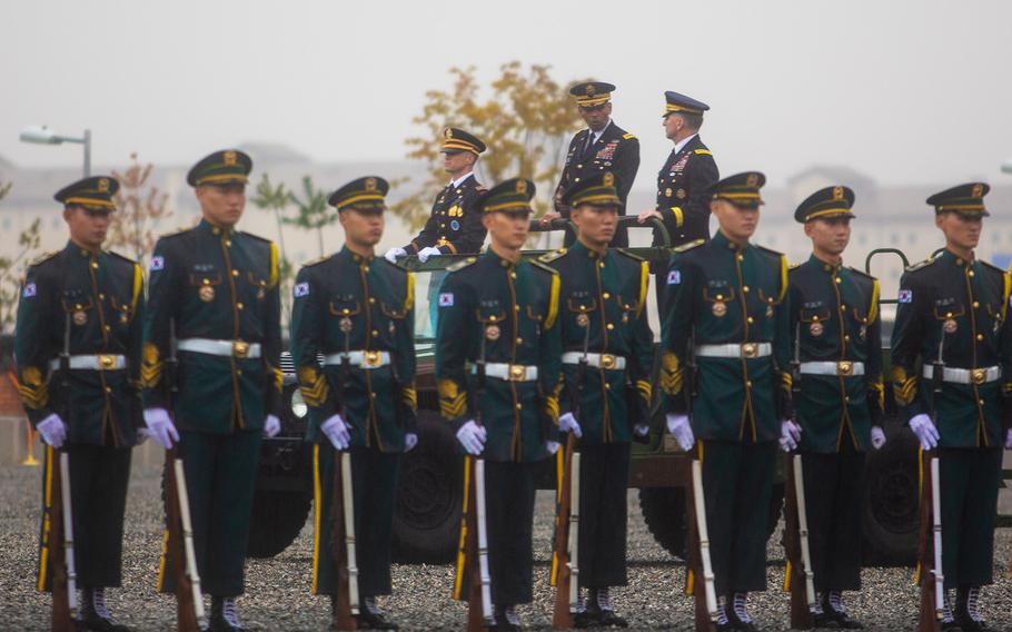 Gen. Vincent Brooks and Gen. Robert Abrams, outgoing and incoming commanders of U.S. Forces Korea, inspect troops at Camp Humphreys, South Korea, Thursday, Nov. 8, 2018.