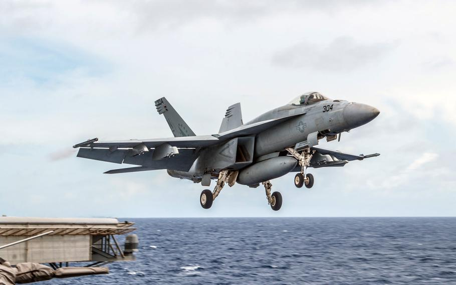 """An F/A-18E Super Hornet launches from the flight deck of the USS Ronald Reagan. Two Navy pilots are safe after ejecting from an F/A-18 Super Hornet that """"experienced a mechanical issue"""" over the Philippine Sea on Monday morning, a Navy statement said."""