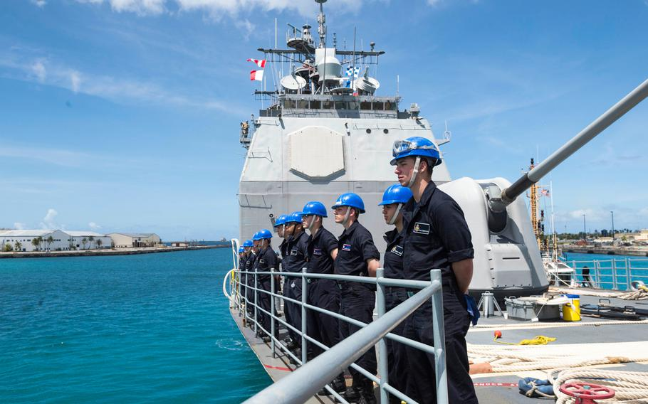 Sailors assigned to the guided-missile cruiser USS Antietam stand in an honor line during a sea and anchor detail in Guam on March 3, 2018.