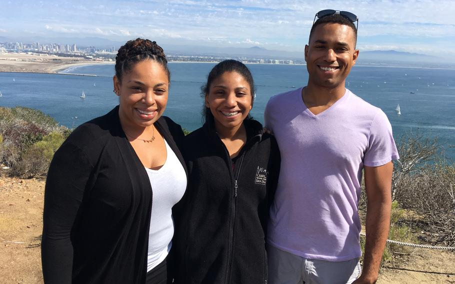 Capt. Jahmar Resilard with his niece Anaiyah Williams, center, and older sister Janine Horne, left.