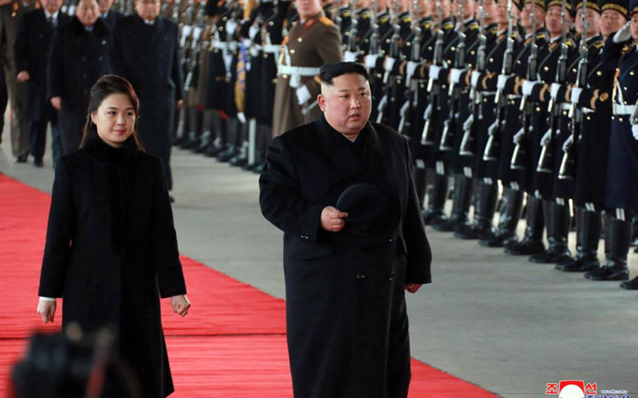 In this image from the Korean Central News Agency, North Korean leader Kim Jong Un and his wife, Ri Sol Ju, walk in Pyongyang before boarding a train to China, Monday, Jan. 7, 2019.