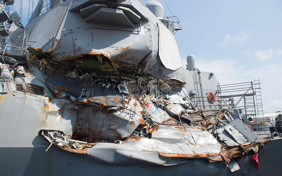 In a July 13, 2017, photo, the USS Fitzgerald sits in Dry Dock 4 at Fleet Activities Yokosuka, Japan, to continue repairs and assess damage sustained from its collision with a merchant vessel.