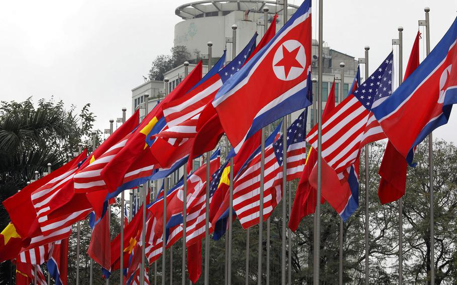 National flags of the U.S., North Korea and Vietnam are displayed at the International Media Center for the U.S-North Korean summit in Hanoi, Vietnam, Monday, Feb. 25, 2019.