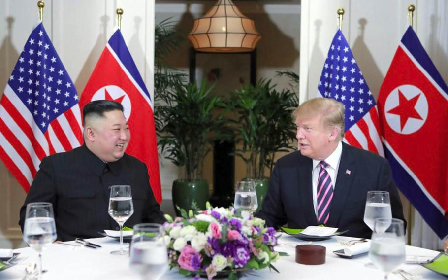This photo from the Korean Central News Agency shows President Donald Trump and North Korean leader Kim Jong Un at dinner in Hanoi, Vietnam, Wednesday, Feb. 27, 2019.
