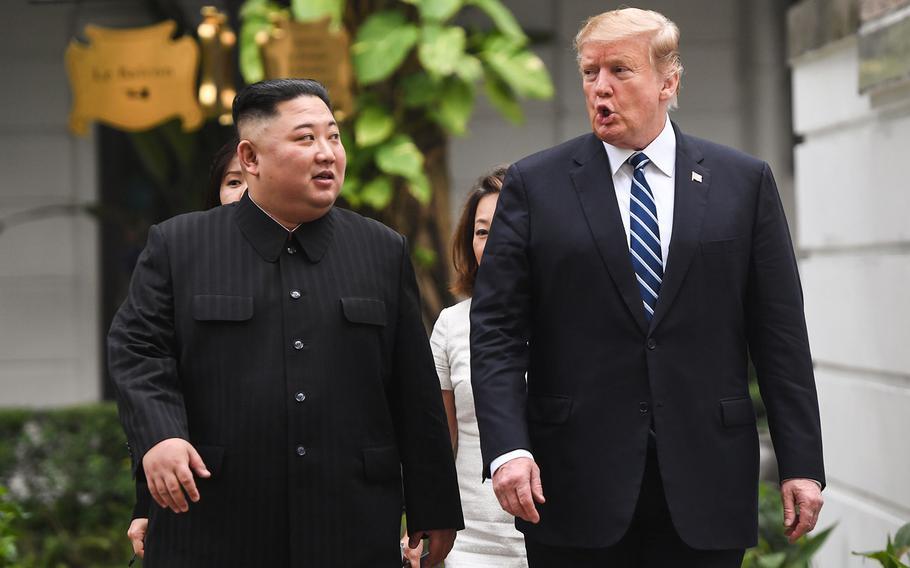 U.S. President Donald Trump walks with North Korea's leader Kim Jong Un during a break in talks at the Sofitel Legend Metropole hotel in Hanoi on Feb. 28, 2019.