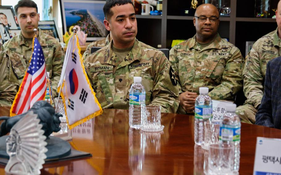 Army Spc. Jonathan Roman Rios, center, is honored for saving a local girl from a dog attack duing a ceremony at Pyeongtaek City Hall, Pyeongtaek, South Korea, Thursday, March 28, 2019.