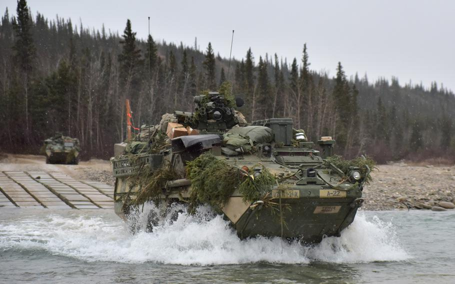 Strykers from the 1st Stryker Brigade Combat Team, 25th Infantry Division, cross Jarvis Creek in the Alaska's Donnelly Training Area Oct. 19, 2018, during Arctic Anvil 19-01.
