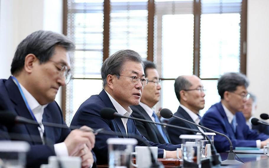 South Korean President Moon Jae-in, second from left, speaks during a meeting of senior aides in Seoul, South Korea, Monday, April 15, 2019.