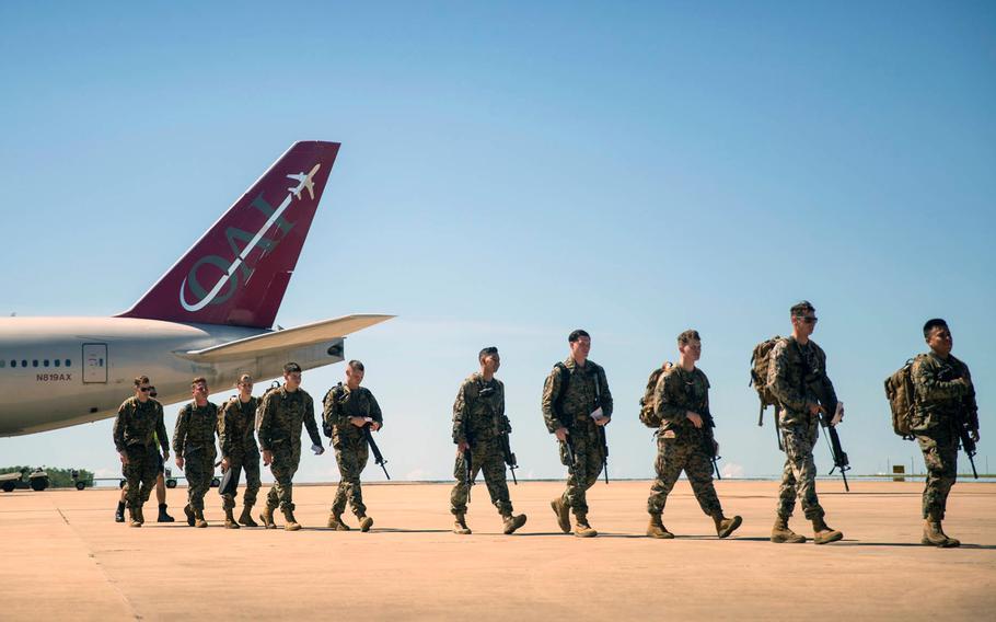 U.S. Marines of Marine Rotational Force Darwin exit a Boeing 777 at the Royal Australian Air Force base at Darwin, Australia, on April 12, 2019.