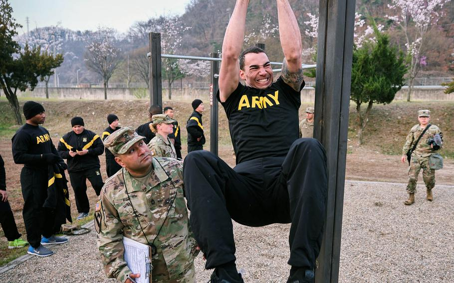 A soldier assigned to 2nd Infantry Division performs the leg tuck during the Best Warrior Competition at Camp Casey, South Korea, on April 18, 2019.