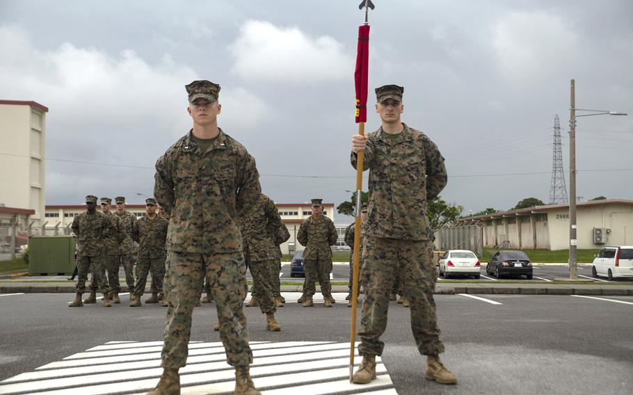 The official party of the Defense Cyberspace Operations Internal Defense Measures Company stand at parade rest during the company's activation ceremony at Camp Hansen, Okinawa, Japan, Dec. 7, 2018.