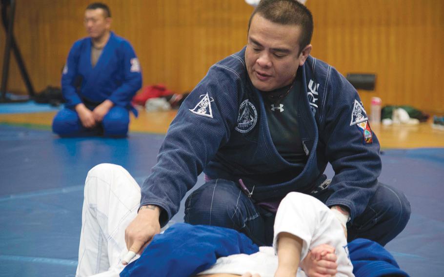 Rodrigo Gomez teaches jiujitsu at Misawa Air Base, Japan, Feb. 17, 2016.