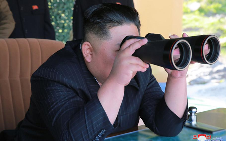 In this undated file photo released May 10, 2019 by the state-run Korean Central News Agency, North Korean leader Kim Jong Un observes a missile launch.