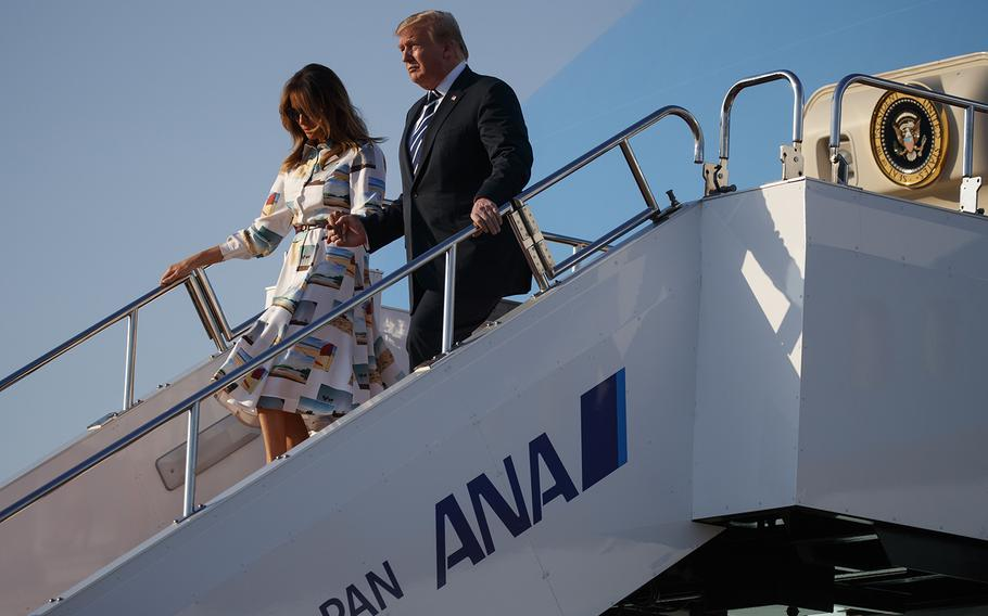President Donald Trump and fist lady Melania Trump arrive at Haneda International Airport for a state visit, Saturday, May 25, 2019, in Tokyo.