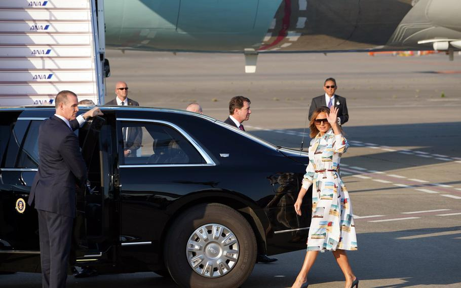 First lady Melania Trump waves to a crowd after landing with President Donald Trump at Haneda International Airport in Tokyo, Saturday, May 25, 2019.