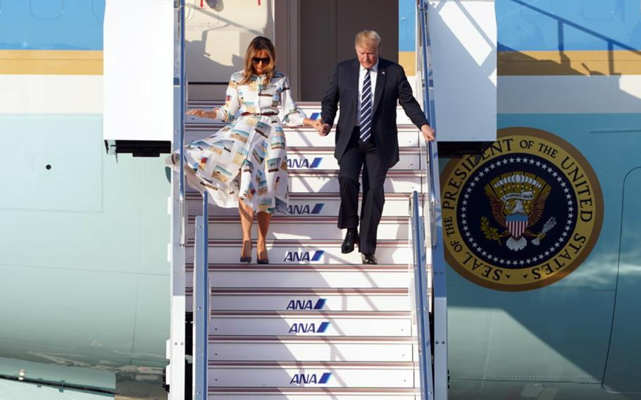 President Donald Trump exits Air Force One with first lady Melania Trump after landing at Haneda International Airport in Tokyo, Saturday, May 25, 2019.