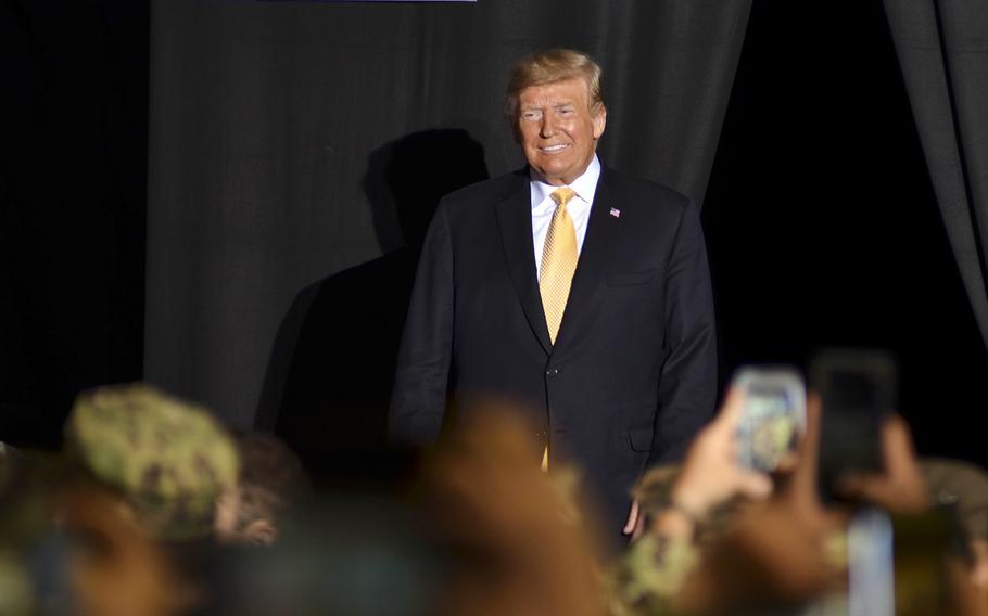 President Donald Trump greets servicemembers aboard the amphibious assault ship USS Wasp at Yokosuka Naval Base, Japan, Tuesday, May 28, 2019.