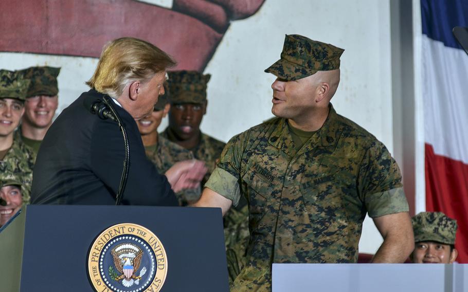 President Donald Trump greets Marine Staff Sgt. Daniel Patterson aboard the USS Wasp at Yokosuka Naval Base, Japan, Tuesday, May 28, 2019.