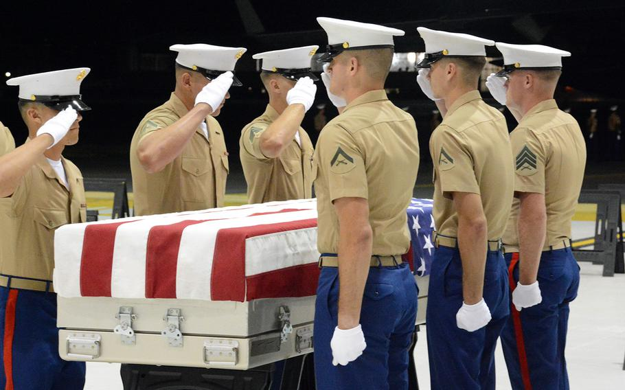 Marine Corps pallbearers salute the remains of an unidentified servicemember being returned from Tarawa during a ceremony at Joint Base Pearl Harbor-Hickam, Hawaii, Wednesday, July 17, 2019.
