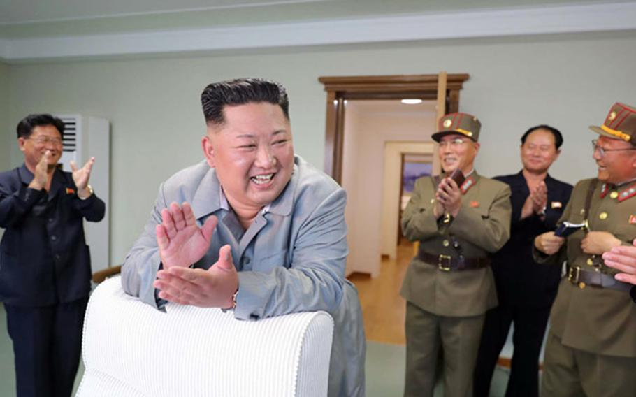 North Korean leader Kim Jong Un celebrates in this undated photo released by the Korean Central News Agency, Friday, July 26, 2019.