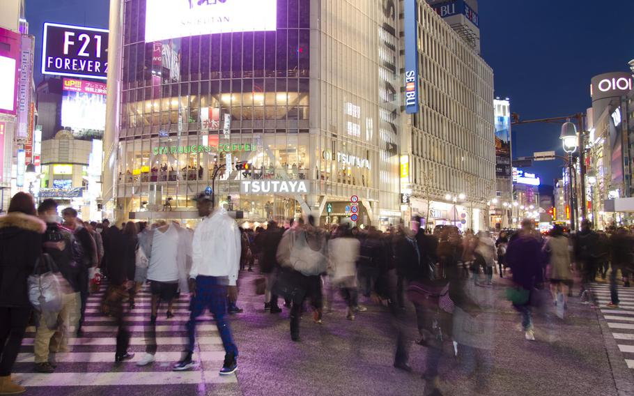 Pedestrians cross the crowded streets in Tokyo's Shibuya area in March 2014. A sailor was found not guilty Wednesday, Aug. 14, 2019, of sexually assaulting a fellow sailor after a night of drinking in the popular nightlife district.