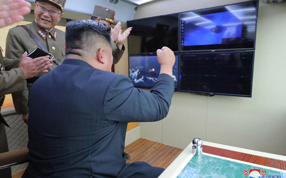 This undated photo, released by the state-run Korean Central News Agency on Aug. 17, 2019, shows North Korean leader Kim Jong Un observing the test-firing of a 'new weapon,' according to KCNA.