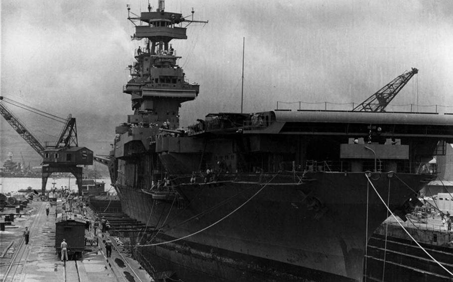 USS Yorktown undergoing repairs in Dry Dock 1 at the Pearl Harbor Navy Yard on May 29, 1942, the day before setting sail for Midway Island.