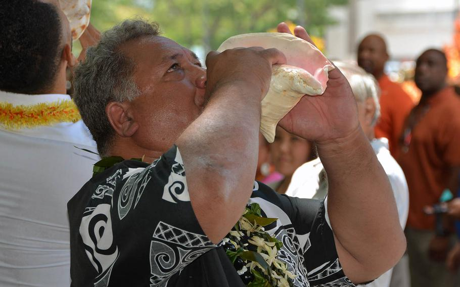 Carson Peapealalo sounds a conch shofar to conclude a ceremony marking the centennial anniversary of Pearl Harbor Naval Shipyard's Dry Dock 1, on Wednesday, Aug. 21, 2019.