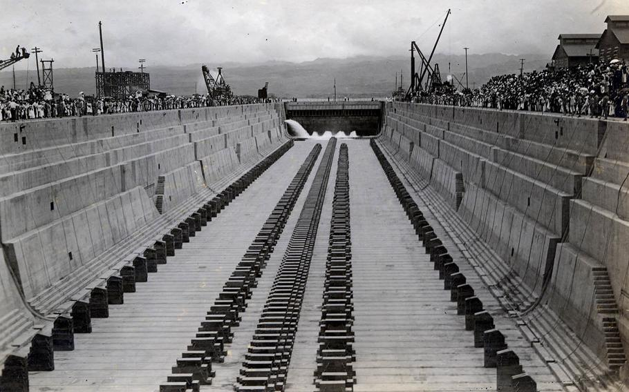 Dry Dock 1 is flooded for the first time during a ceremony held Aug. 21, 1919.