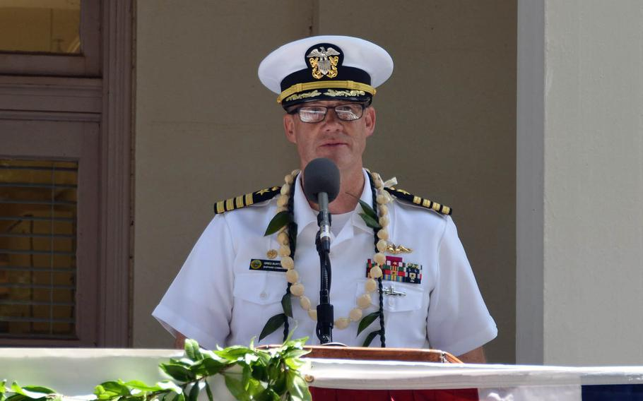 Capt. Gregory Burton, commander of Pearl Harbor Naval Shipyard, speaks at a ceremony, marking the centennial anniversary of the shipyard's Dry Dock 1, on Wednesday, Aug. 21, 2019.