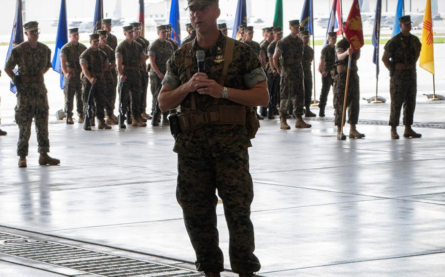 Col. Frederick L. Lewis Jr., incoming commander of Marine Corps Air Station Iwakuni, Japan, speaks to Marines and sailors at the change-of-command ceremony Thursday, Aug. 22, 2019.