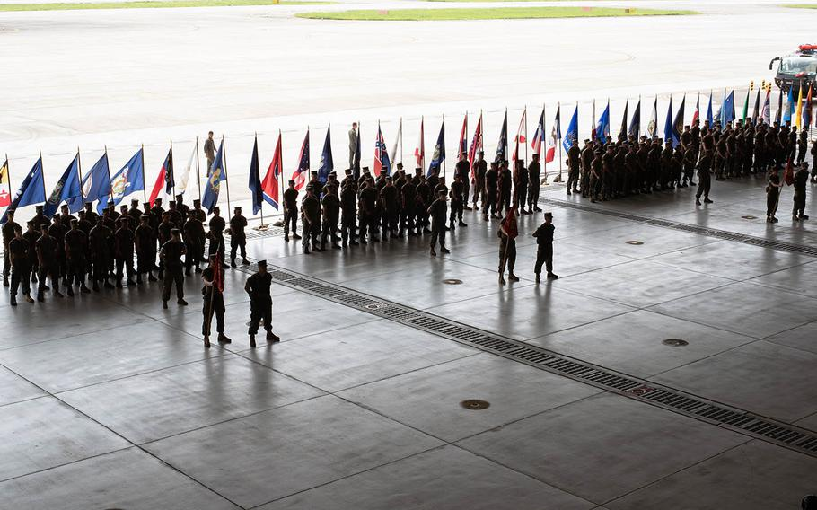 Marines stand in formation as  Col. Frederick L. Lewis Jr. assumes command at Marine Corps Air Station Iwakuni, Japan, from Col. Richard F. Fuerst on Thursday, Aug. 22, 2019.