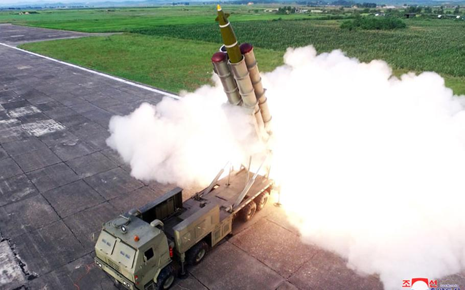 """North Korea shows the launch of what it called a """"super-large multiple rocket launcher system"""" that was observed by leader Kim Jong Un."""
