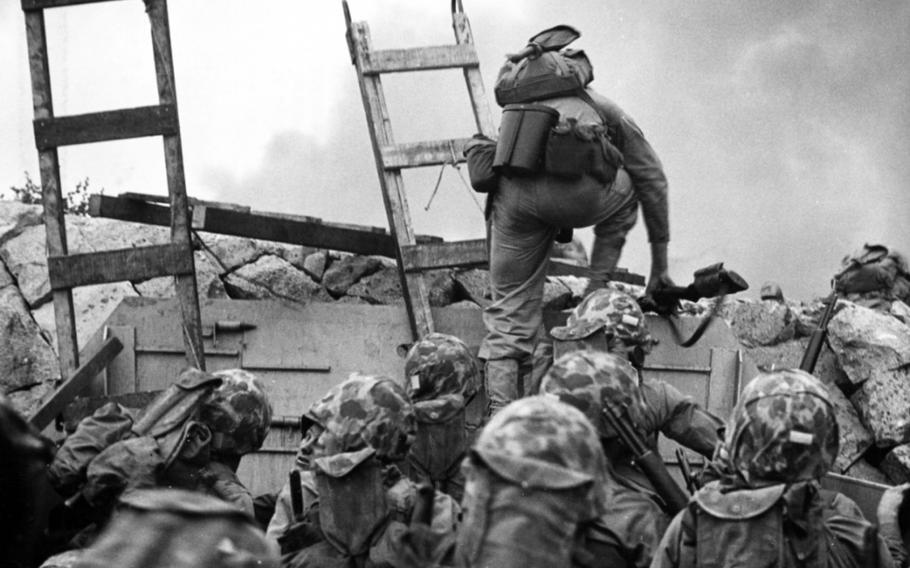 First Lt. Baldomero Lopez leads Marines over a seawall during the Incheon landing on Sept. 15, 1950.