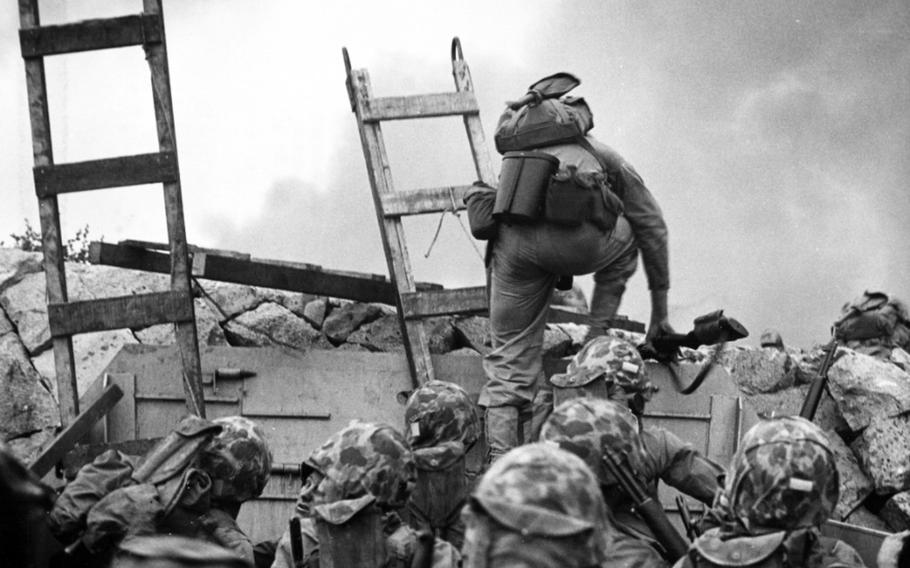 1st Lt. Baldomero Lopez leads Marines over a seawall during the Incheon landing on Sept. 15, 1950.