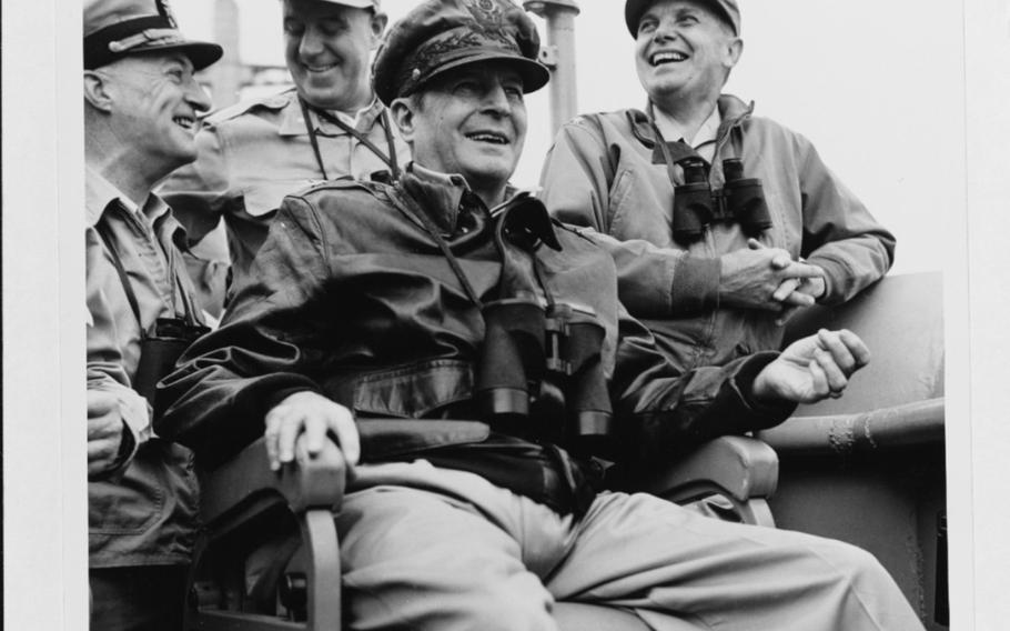 Gen. Douglas MacArthur, center, is shown on board USS Mount McKinley during the Incheon landings on Sept. 15, 1950.