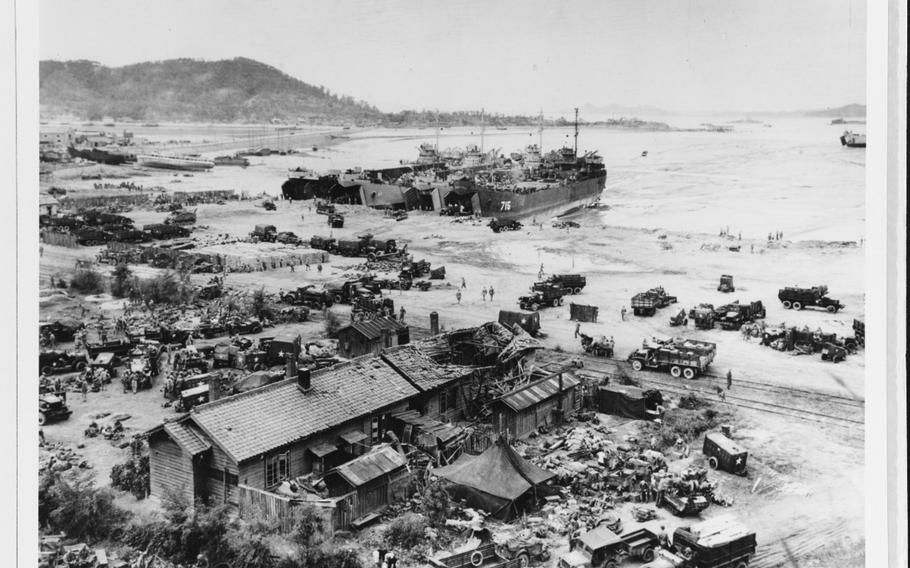 Men and equipment are unloaded at low tide on Incheon's Red Beach, Sept. 16, 1950, the day after the initial landings there.