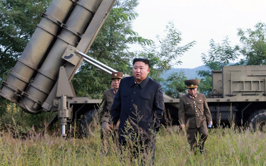 North Korean leader Kim Jong Un stands near a mobile launcher in this photo released by the Central Korean News Agency on Wednesday, Sept. 11, 2019.
