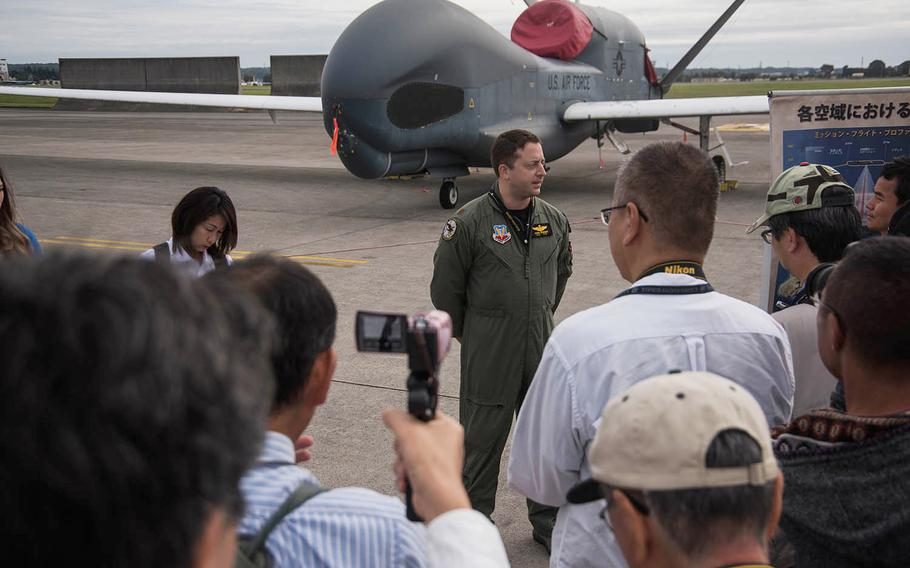Maj. John Wright, a spokesman for the U.S. Air Force 319th Operations Group, answers questions about the RQ-4 Global Hawk at the annual Yokota Air Base, Japan, Friendship Festival on Saturday, Sept. 14, 2019.