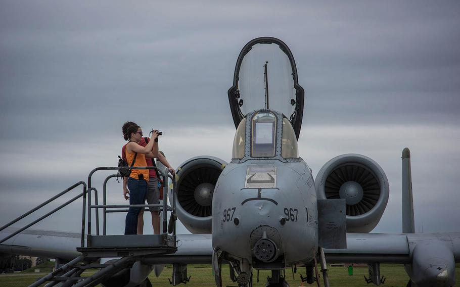 Attendees at the annual Yokota Airbase Friendship Festival photograph an A-10 Thunderbolt II from the South Korea-based 25th Fighter Squadron on Saturday, Sept. 14, 2019.